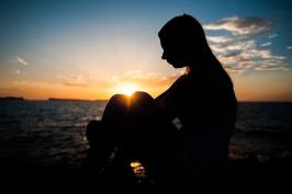 Woman sitting near water